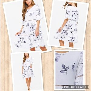 Flowy swing style floral dress with bell sleeves
